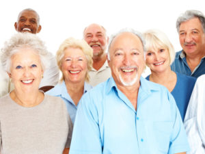 Group of retired people smiling against white background